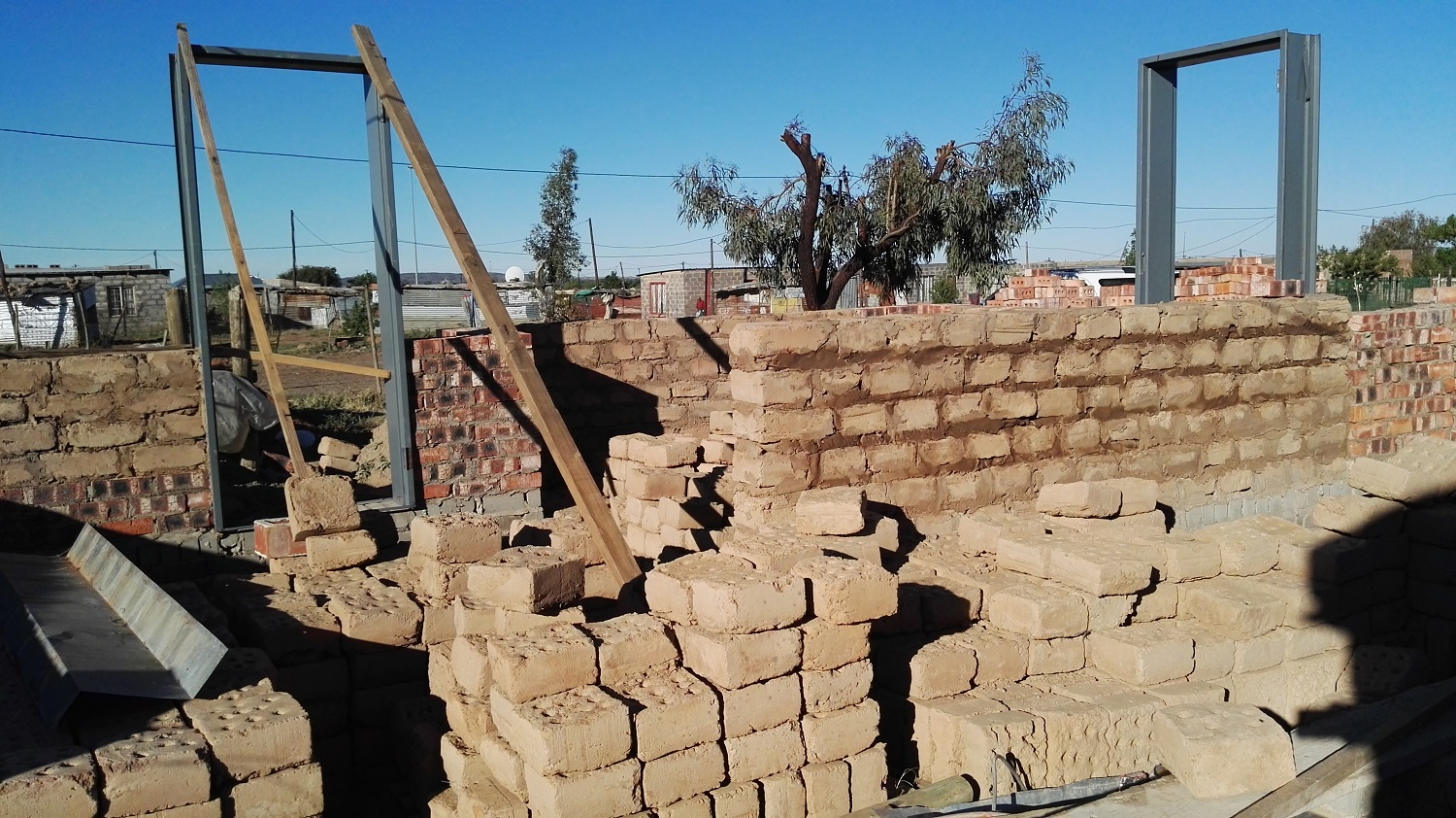 In 2018 the builders decided to use a combination of clay bricks and earth bricks as major construction material.