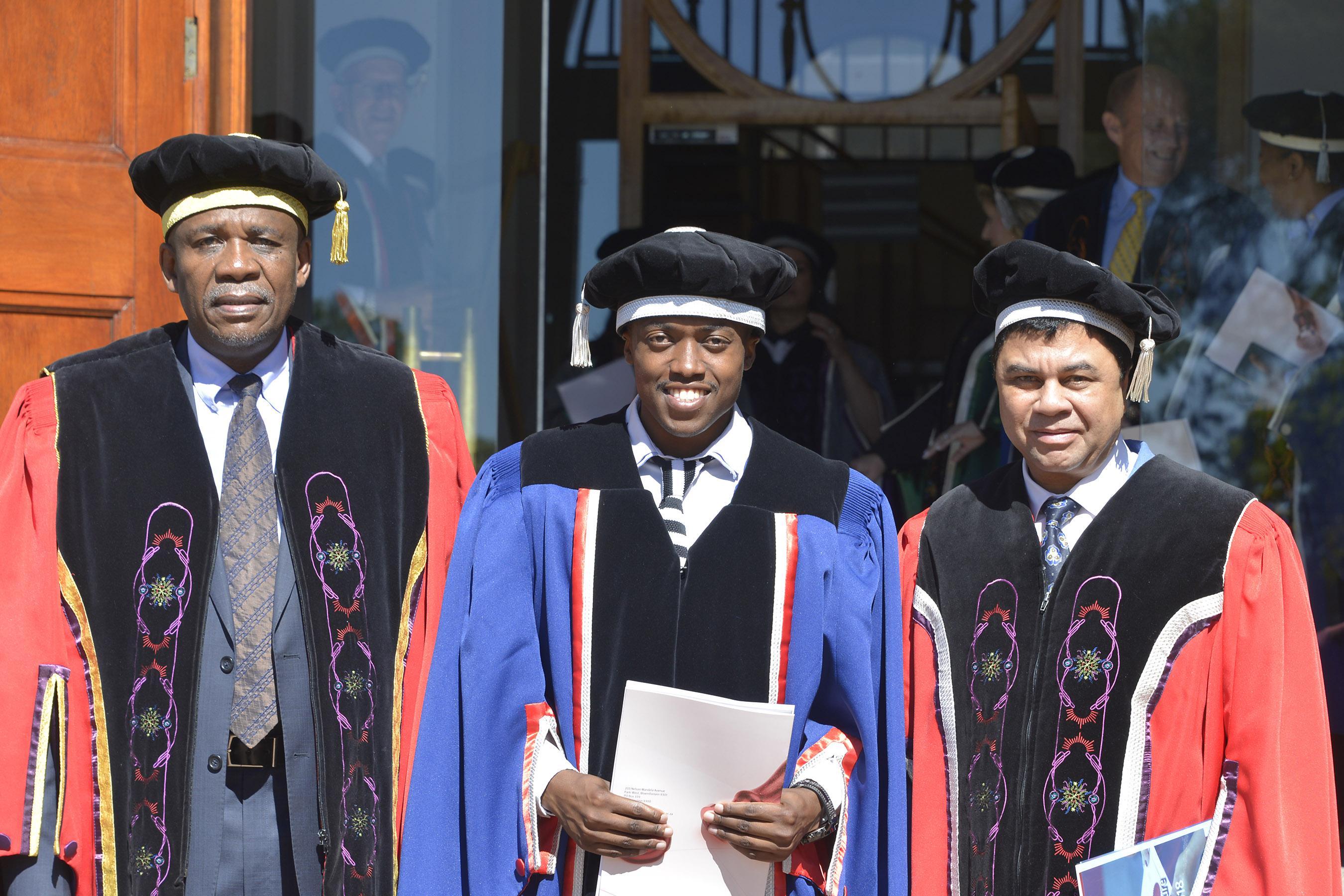 Dr Khosto Mokhele, UFS Chancellor, Ace Moloi and Prof Francis Petersen, UFS Rector and Vice-Chancellor
