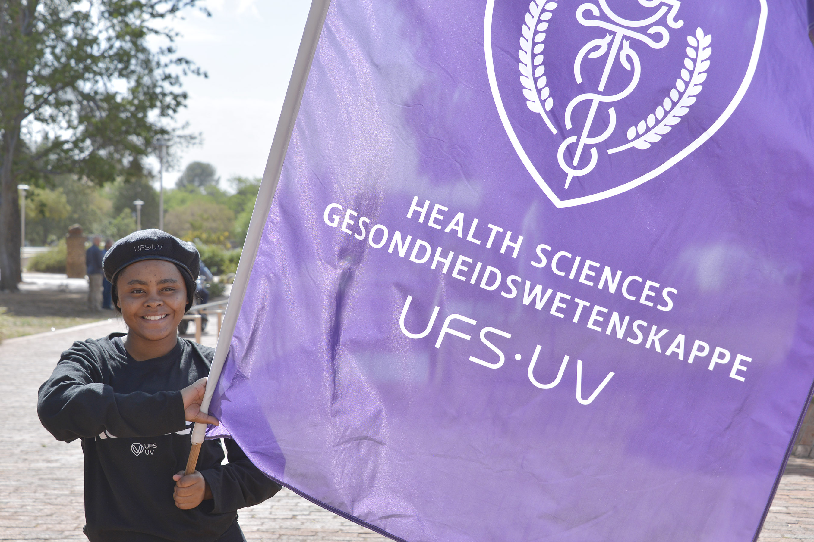 Flag bearer with the Faculty of Health Sciences