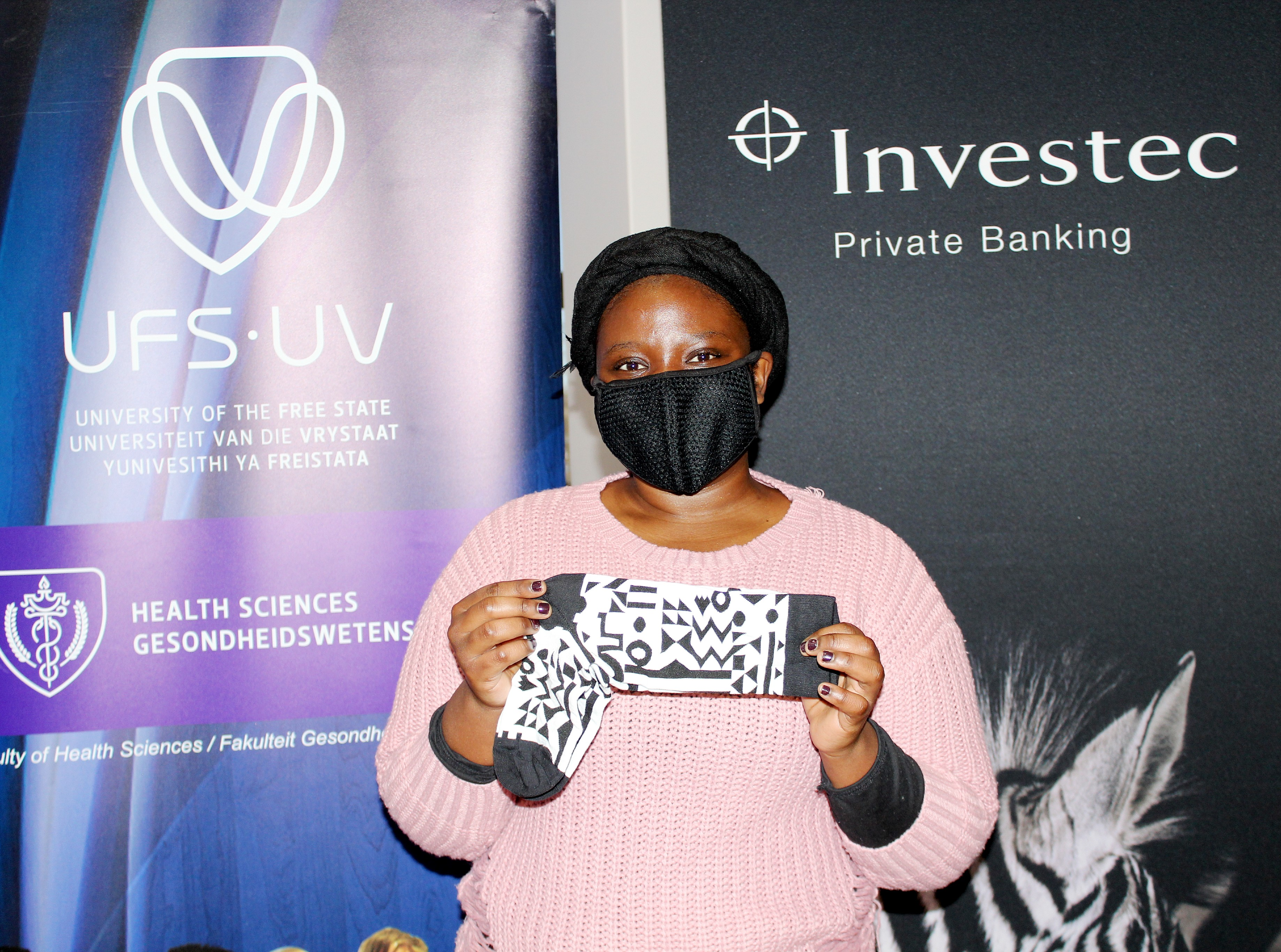 Nkabaneng Mamve, second-year student, shows off the crazy socks that she received on Friday (4 June 2021) from Investec Private Banking in support of the CrazySocks4Docs initiative.