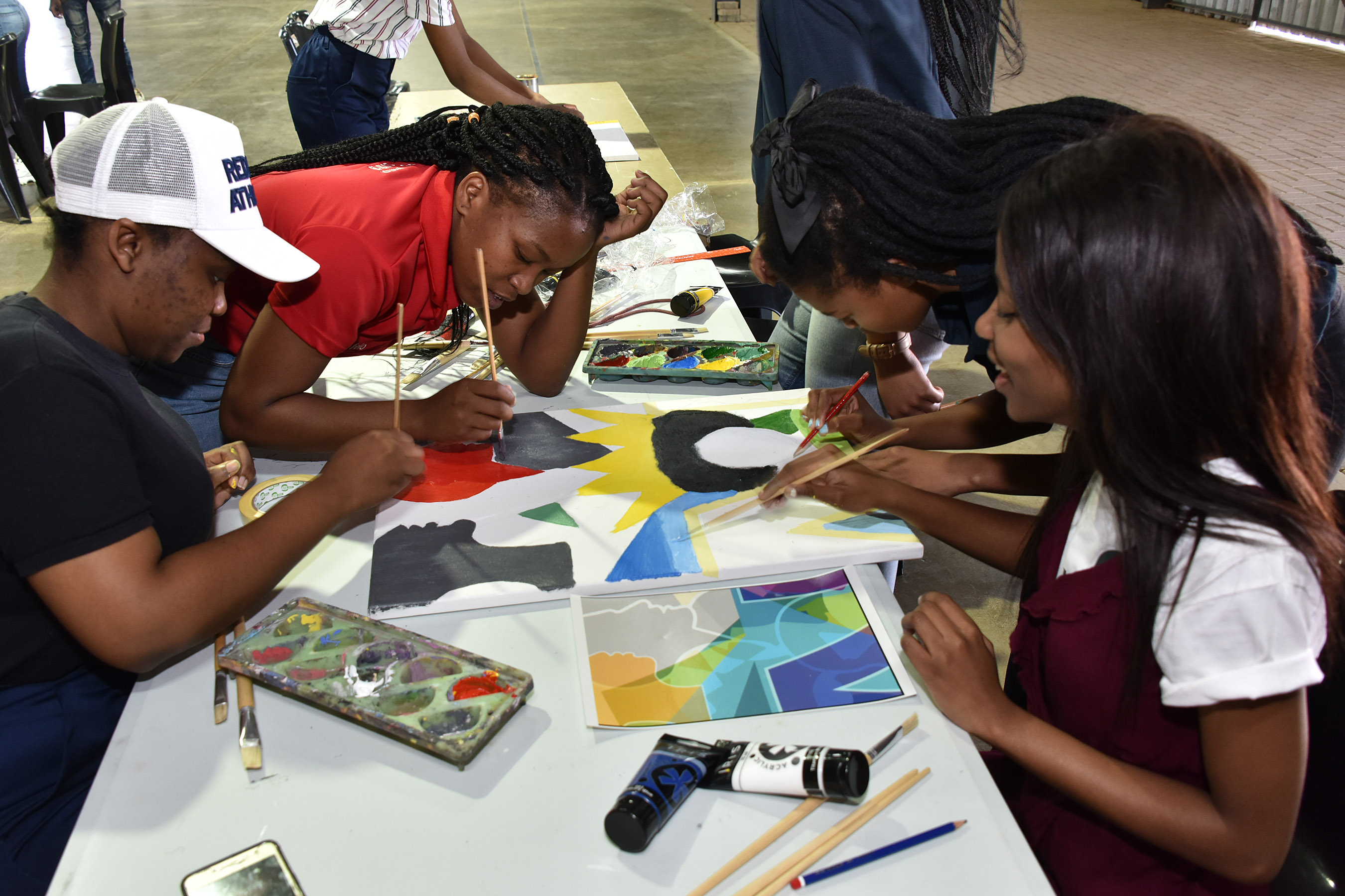 The first activity of the Multilingual Mokete kicked off with a canvas painting which will later become part of a bigger murial which will be on display in the Scaena