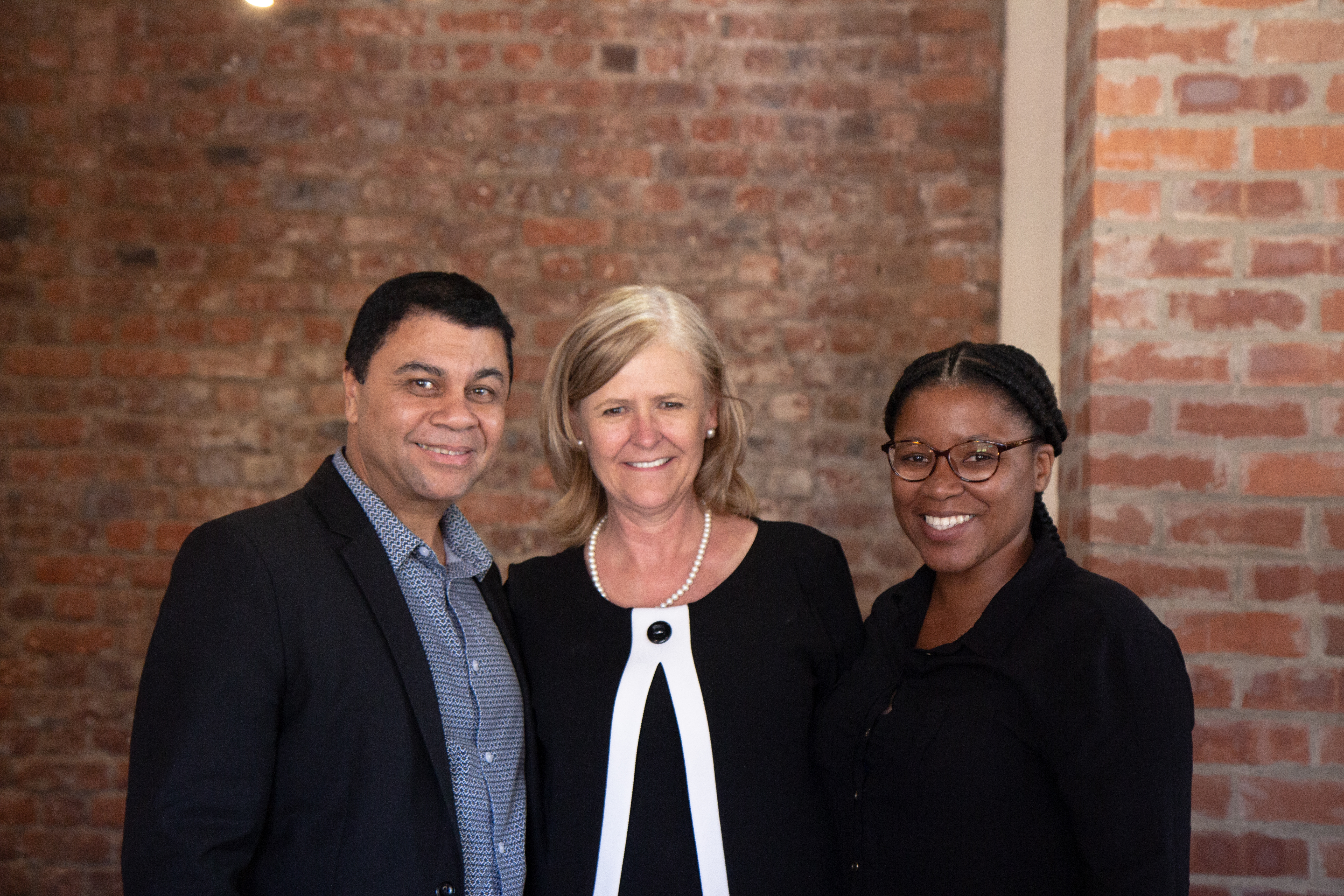 Prof Francis Petersen, Rector and Vice-Chancellor with Dr Adri Van Der Merwe and Avela Ntsongelwa