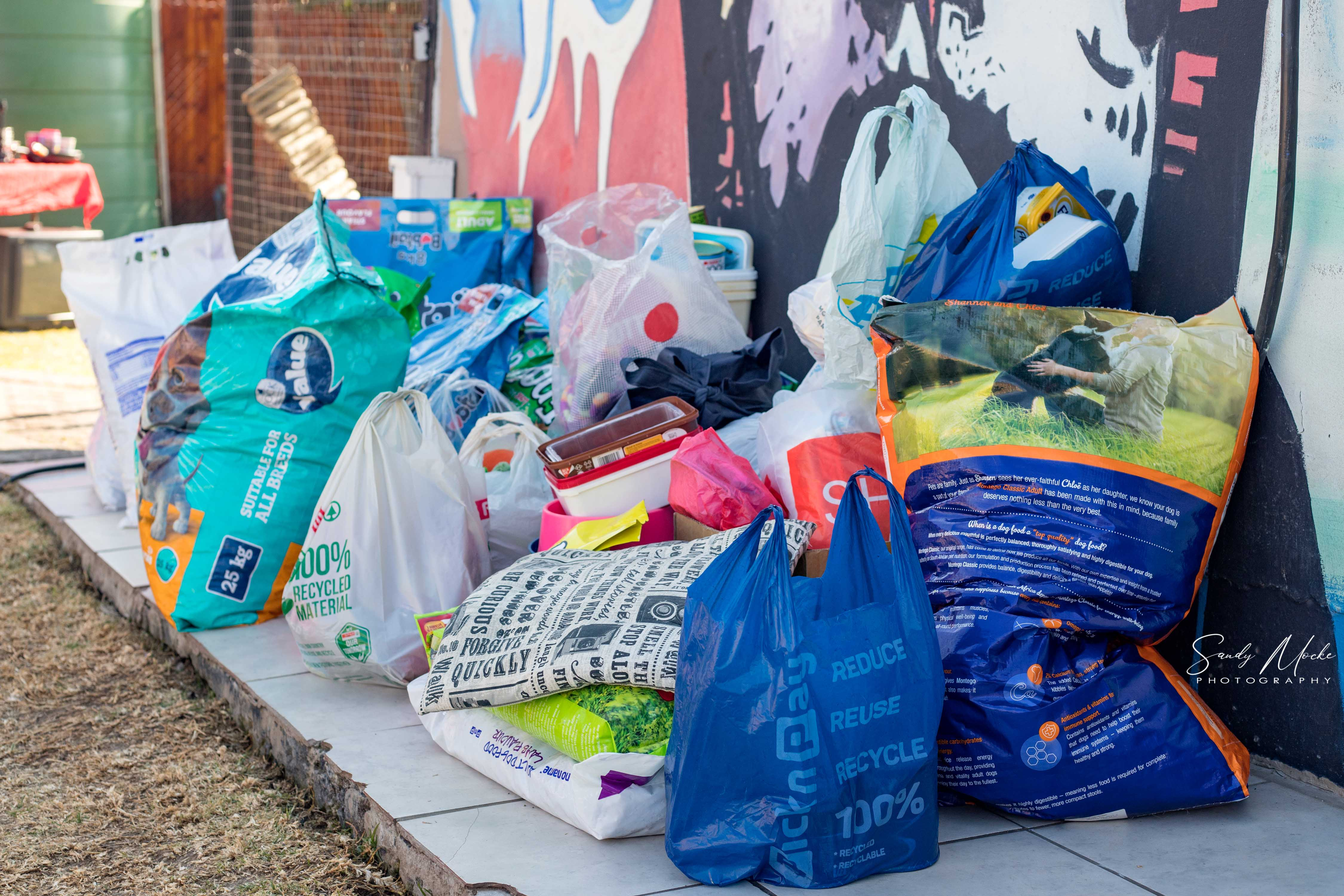 Pet food donated for destitute animals at the New Beginnings Animal Rescue Centre by the FARMOVS Clinical Research Facility staff. Photo: Sandy Mocke.