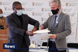 Prof Philippe Burger (Vice-Dean in the Faculty of Economic and Management Sciences, UFS) and Mr Busani Ncgaweni (Principal, NSG) at the NSG signing ceremony in Pretoria, 3 June 2021.