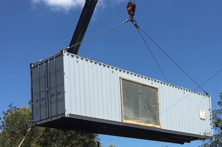 The repurposed shipping containers were lifted by crane over trees and onto a concrete platform on the Bloemfontein Campus of the UFS before they were transformed into a state-of-the-art biosafety Level (BSL) 3 laboratory.