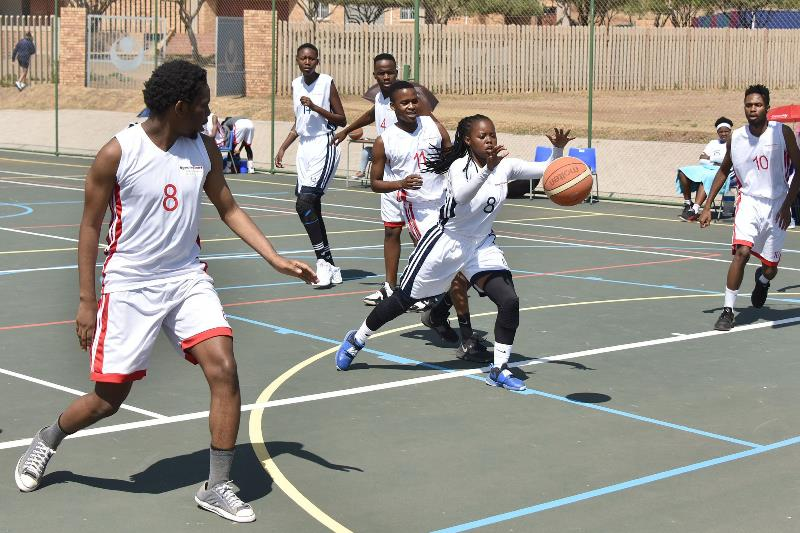 Students warm up for a basketball match between the Bloemfontein and South Campus teams. Photo: Johan Roux