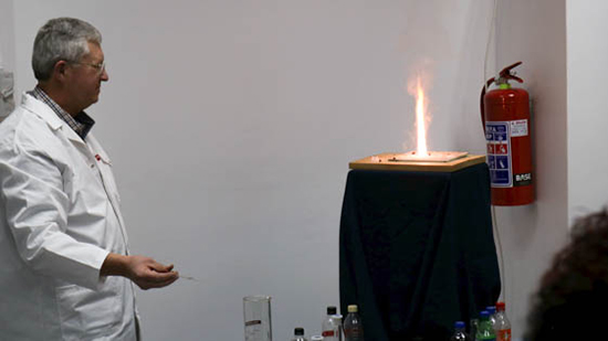 Prof Johan Venter monitors an experiment during a Chemistry magic